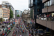 Participants taking part along Upper Thames Street in the London Marathon on 28th April 2019 in London, England, United Kingdom. The London Marathon, presently known through sponsorship as the Virgin Money London Marathon, is a long-distance running event. The event was first run in 1981 and has been held in the spring of every year since. The race is mainly known for ebing a public race where ordinary people can challenge themsleves while raising great amounts of money for various charities.