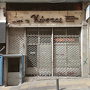 """A closed down photocopy shop in Plateia Theatrou, Athens, with an older sign """"O Kostas"""""""