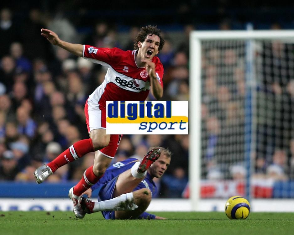 Photo: Lee Earle.<br /> Chelsea v Middlesbrough. The Barclays Premiership.<br /> 03/12/2005. Chelsea's Eidur Gudjohnsen sends Emanuel Pogatetz flying.