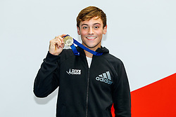 Tom Daley from Dive London Aquatics Club celebrates after winning the Gold medal in the Mens 10m Platform Final to confirm his place in the GB squad for the Rio 2016 Olympic Games - Mandatory byline: Rogan Thomson/JMP - 12/06/2016 - DIVING - Ponds Forge - Sheffield, England - British Diving Championships 2016 Day 3.