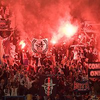 19 May 2007: Supporters of the french soccer team Paris Saint-Germain (PSG) Football Club light flares and hold banners in the Boulogne stands prior to the Ligue 1 football game against Troyes at the Parc des Princes stadium, in Paris, France.