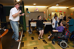 Members and guests enjoying a social event organised by disability friendship club,