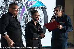LowRide Magazine Italy's Giuseppe Roncen presents an award at his bike show award ceremony during Motor Bike Expo. Verona, Italy. Sunday January 21, 2018. Photography ©2018 Michael Lichter.