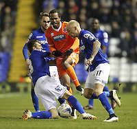 Blackpool's Nathan Delfouneso is tackled by Birmingham City's Jonathan Grounds and  David Cotterill<br /> <br /> Photographer Mick Walker/CameraSport<br /> <br /> Football - The Football League Sky Bet Championship - Birmingham City v Blackpool - Wednesday 4th March 2015 - St Andrews - Birmingham<br /> <br /> © CameraSport - 43 Linden Ave. Countesthorpe. Leicester. England. LE8 5PG - Tel: +44 (0) 116 277 4147 - admin@camerasport.com - www.camerasport.com