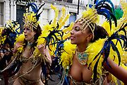 Parade with Brazilian dancers in fine costumes on the second day of the Notting Hill Carnival in West London. The Notting Hill Carnival is an annual event which since 1964 has taken place each August, over two days (the August bank holiday Monday and the day beforehand). It is led by members of the West Indian / Caribbrean community, particularly the Trinidadian and Tobagonian British population, many of whom have lived in the area since the 1950s. The carnival has attracted up to 2 million people in the past, making it the second largest street festival in the world. The celebration centres around a parade of floats, dancers and sound systems.