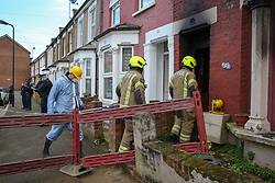© Licensed to London News Pictures. 10/02/2020. London, UK. Forensic officer and firemen enter a property on Olinda Road, in Hackney, North London following a fire where a woman died. Police were called to Olinda Road at around midnight. According to the neighbours, the woman was in her 70s. Photo credit: Dinendra Haria/LNP