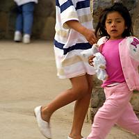 North America, Mexico, Baja California, Ensenada. Kids at La Bufadora - two girls stepping.