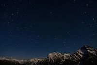 Mount Krivàn (2495 m asl), national symbol of Slovakia. The massif with Mount Hruba Kopa (2238 m asl), clouds and stars at night. High Tatras, Slovakia. June 2009. Mission: Ticha