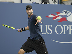 August 22, 2017 - New York, New York, United States - Alexander Sarkissian of USA returns ball during qualifying game against Reilly Opelka of USA at US Open 2017 (Credit Image: © Lev Radin/Pacific Press via ZUMA Wire)