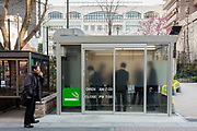 A smoking room in a park in Akihabara, Tokyo, Japan. Thursday March 16th 2017