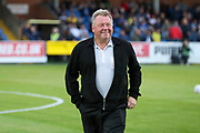 AFC Wimbledon manager Wally Downes walking onto pitch and smiling during the Pre-Season Friendly match between AFC Wimbledon and Crystal Palace at the Cherry Red Records Stadium, Kingston, England on 30 July 2019.