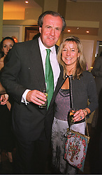 MR & MRS JUSTIN CADBURY  at a party in London on 1st June 1999.MSP 23
