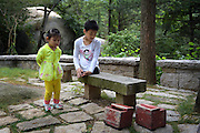 QINGDAO, CHINA - SEPTEMBER 10: <br /> <br /> Legless motivational speaker Chen Zhou (R) and legless teenager Gao Zhiyu climb the Mount Lao on September 10, 2016 in Qingdao, Shandong Province of China. 11-year-old Gao Zhiyu form Shandong Jimo, accompanied by 32-year-old motivational speaker Chen Zhou form Shandong Linyi, climbed the Mount Lao and finally arrived at the 900-meter-high site after over five hours\' climbing on Saturday in Qingdao. <br /> ©Exclusivepix Media