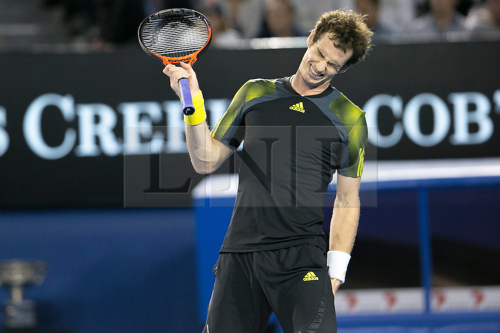 © Licensed to London News Pictures. 27/01/2013. Melbourne Park, Australia. Andy Murray holds onto his injured hamstring while grimacing during the Mens Final between Novak Djokovic and Andy Murray of the Australian Open. Photo credit : Asanka Brendon Ratnayake/LNP