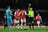 Football - 2019 / 2020 Premier League - Arsenal vs. Brighton & Hove Albion<br /> <br /> Arsenal's Hector Bellerin is shown a yellow card by Referee Graham Scott, at The Emirates.<br /> <br /> COLORSPORT/ASHLEY WESTERN