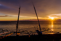 Nusa Tenggara, Lombok, Senggigi. Sunset on Senggigi, fishingboats in the foreground. In the background you can see Nusa Penida outside Bali.