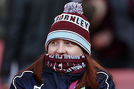 a Burnley fan covers up from the cold before k/o.The Emirates FA cup, 4th round match, Arsenal v Burnley at the Emirates Stadium in London on Saturday 30th January 2016.<br /> pic by John Patrick Fletcher, Andrew Orchard sports photography.