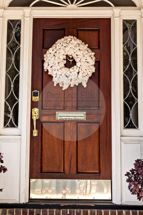 A  Christmas wreath made from cotton bolls decorate the wooden door of a historic home on East Bay Street in Charleston, South Carolina.
