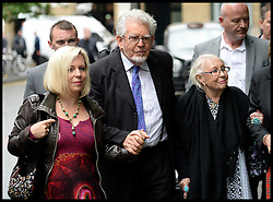 Rolf Harris arrives at Southwark Crown Court, London, United Kingdom, with His daughter (left) and his wife Alwen Hughes  (right) he is expected to give evidence in his trial today. Tuesday, 27th May 2014. Picture by Andrew Parsons / i-Images