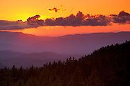 Sunset through clouds and forest from Crater Lake National Park, Oregon