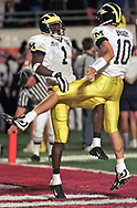 """David Terrell gives his QB Tom Brady a painful """"Hello"""" while the two celebrate Terrell's 27 yard touchdown catch near the end of the second quarter of the 2000 FedEx Orange Bowl game between the Michigan Wolverines and the Alabama Crimson Tide on January 1, 2000, at Pro Player Stadium in Miami Gardens, Florida. Michigan defeated Alabama 35–34 in an overtime battle."""
