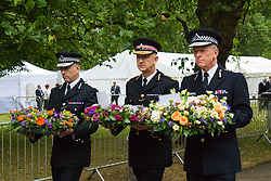 Hyde Park, London, July7th 2015. The Mayor of London Boris Johnson and other senior political figures, the Commissioners for transport and policing in the capital, as well as senior representatives of the emergency services  lay wreaths at the 7/7 memorial in Hyde Park. PICTURED: Sir Bernard Hogan Howe, right is accompanied by British Transport Police Commissioner Paul Crowther OBE and Adrian Leppard QPM - commissioner for City of London.
