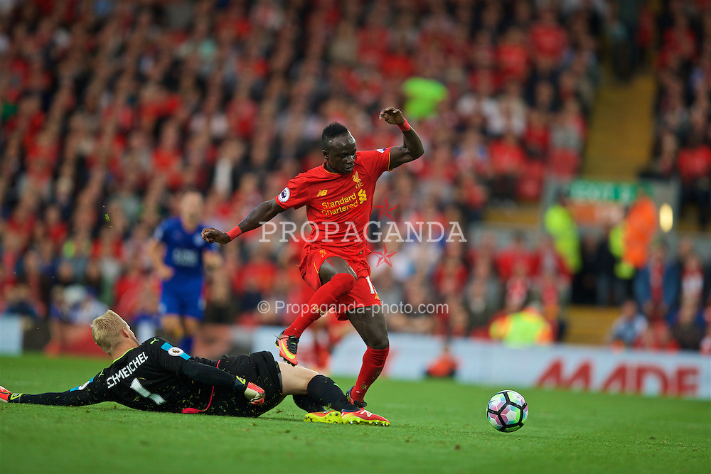 LIVERPOOL, ENGLAND - Saturday, September 10, 2016: Liverpool's Sadio Mane skips over the advancing Leicester City's goalkeeper Kasper Schmeichel to set up the fourth goal during the FA Premier League match at Anfield. (Pic by David Rawcliffe/Propaganda)