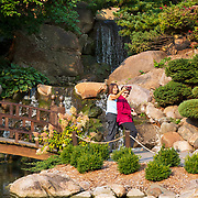 Elaine Diaz, left, and Rosanne Chua walk next to the Koi Pond at the Dubuque Arboretum and Botanical Gardens in Dubuque, Iowa. Nathan Lambrecht/Journal Communications