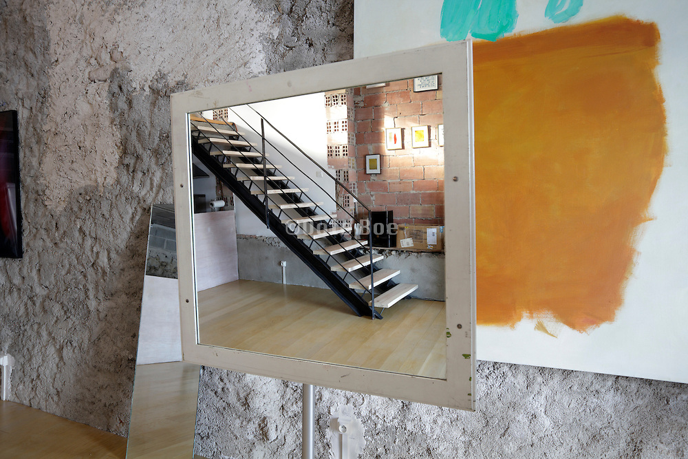 mirror placed in a room with artworks in the walls