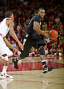 Nov 16, 2011; Fayetteville, AR, USA; Oakland Grizzlies guard Blake Cushingberry (23) dribbles against an Arkansas Razorback player during a game at Bud Walton Arena. Arkansas defeated Oakland 91-68. Mandatory Credit: Beth Hall-US PRESSWIRE