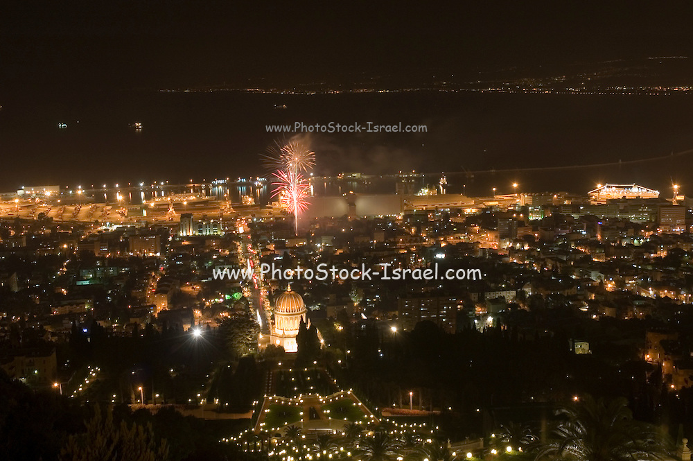 Israel Haifa, fireworks display in the bay, as seen from the Carmel mountain. The bahai shrine can be seen