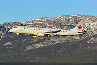 Sunset landing for this Air Canada Embraer 190 Regional Jet