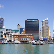 A view of the City of Auckland and Auckland Harbour showing the Ferry Wharf terminal. Auckland, North Island, New Zealand. 26th November 2010.