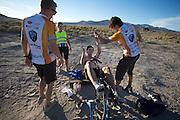 Jan Bos wordt gefeliciteerd met het feit dat hij zijn persoonlijk record nipt heeft vebeterd op de vierde racedag van de WHPSC. In de buurt van Battle Mountain, Nevada, strijden van 10 tot en met 15 september 2012 verschillende teams om het wereldrecord fietsen tijdens de World Human Powered Speed Challenge. Het huidige record is 133 km/h.<br /> <br /> Jan Bos gets congratulated because he has (just) broke his personal record on the fourth day of the WHPSC. Near Battle Mountain, Nevada, several teams are trying to set a new world record cycling at the World Human Powered Vehicle Speed Challenge from Sept. 10th till Sept. 15th. The current record is 133 km/h.