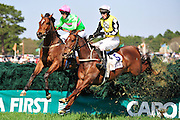 27 March 2010 : Paddy Young and SPY IN THE SKY (right) battle over the last hurdle with Jeff Murphy and MAJOR MALIBU (left). MAJOR MALIBU would go on to take the win in the Gr. II Carolina Cup.