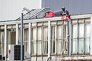 Birmingham, United Kingdom, June 14, 2021: A general view shows Palestine Action activists relaxing over the rooftop of an American industrial factory known as Arconic in Birmingham on Monday, June 14, 2021. This is a protest against the company who they say 'provided cladding for Grenfell Tower' and 'materials for Israel's fighter jets.' (Photo by Vudi Xhymshiti)