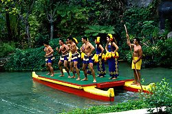 Hawaii: Oahu, Polynesian Cultural Center, Long Canoes and dancers. Photo:hicult105.Photo copyright Lee Foster, 510/549-2202, lee@fostertravel.com, www.fostertravel.com