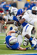Dec 1, 2012; Tulsa, Ok, USA; Tulsa Hurricanes tailback Alex Singleston (8) is brought down by University of Central Florida Knights  defensive lineman Cam Henderson (49) during a game at Skelly Field at H.A. Chapman Stadium. Tulsa defeated UCF 33-27 in overtime to win the CUSA Championship. Mandatory Credit: Beth Hall-USA TODAY Sports