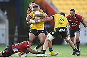 Hurricanes Ngani Laumpae is tackled in the Super Rugby match, Hurricanes v Crusaders, Sky Stadium, Wellington, Sunday, April 11, 2021. Copyright photo: Kerry Marshall / www.photosport.nz