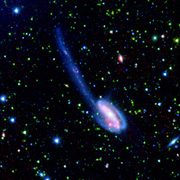 Spitzer Wide-area Infrared Extragalactic (SWIRE) Legacy image of the Tadpole galaxy. Although these galactic mergers are rare in the universe's recent history, astronomers believe that they were much more common in the early universe. Thus, SWIRE team members will use this detailed image of the Tadpole galaxy to help understand the nature of the 'faint red-orange specks' of the early universe.