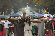 Actor Juan Ponce, 27 (C) portrays Jesus Christ during a Good Friday Via Crucis in Chicago's Rogers Park neighborhood. The religious portrayal recounts the biblical steps of Jesus Christ being condemned to death, followed by his crucifixion and entombment.