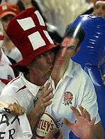 Photo: Richard Lane.<br />France v England. Semi-Final, at the Telstra Stadium, Sydney. RWC 2003. 16/11/2003. <br />An England fan kisses a Martin Johnson inflatable.