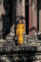 Aug. 2, 2013 - Young Buddhist monk praying outside temple in Angkor Wat, Siem Reap, Cambodia (Credit Image: © Gary  Latham/Cultura/ZUMAPRESS.com)