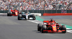 Ferrari's Sebastian Vettel (right), Mercedes' Lewis Hamilton and Ferrari's Kimi Raikkonen during the 2018 British Grand Prix at Silverstone Circuit, Towcester. PRESS ASSOCIATION Photo. Picture date: Sunday July 8, 2018. See PA story AUTO British. Photo credit should read: Martin Rickett/PA Wire. RESTRICTIONS: Editorial use only. Commercial use with prior consent from teams.