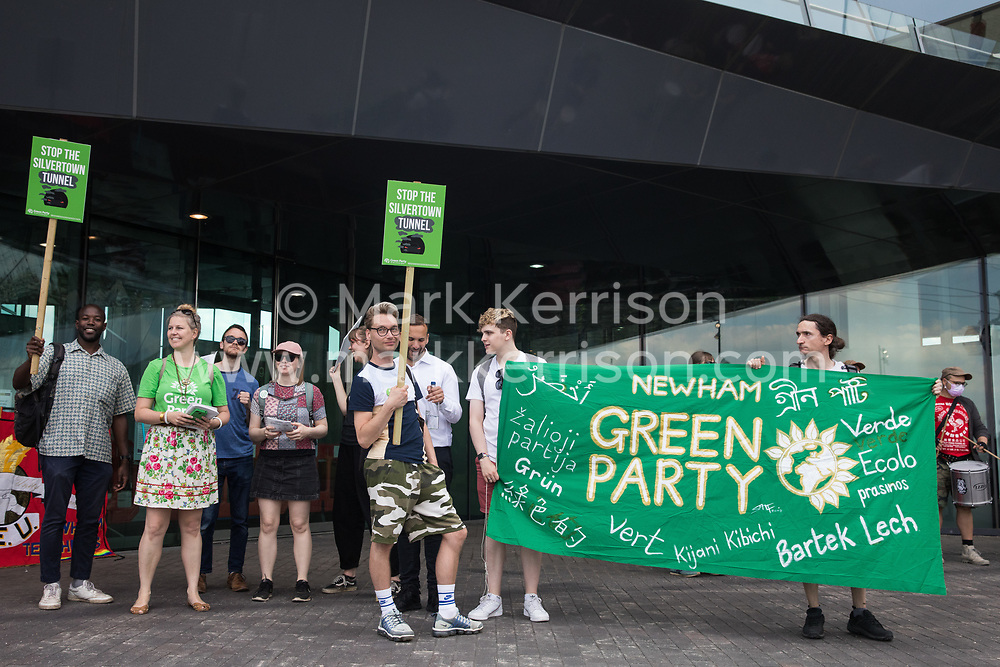 London, UK. 5th June, 2021. Members of Newham Green Party join environmental activists and local residents protesting against the construction of the Silvertown Tunnel. Campaigners opposed to the controversial new £2bn road link across the River Thames from the Tidal Basin Roundabout in Silvertown to Greenwich Peninsula argue that it is incompatible with the UK's climate change commitments because it will attract more traffic and so also increased congestion and air pollution to the most polluted borough of London.