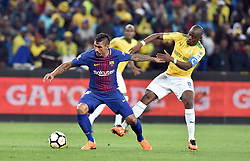 16/05/2018. Hlompho Kekana of Mamelodi Sundowns FC gets away with the ball from Sergio Basquets of  FC Barcelona during the Nelson Mandela Centenaty Challenge at FNB stadium. <br /> Picture: Oupa Mokoena/African News Agency (ANA)