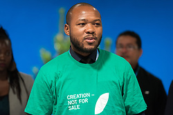 13 December 2019, Madrid, Spain: Faith-based organizations gather for a vigil, as COP25 is about to draw to a close, praying that negotiations will bear fruit, bringing about urgent and just action to find a way out of the climate crisis. Here, Lutheran World Federation delegate and council member Khulekani Sizwe Magwaza from the Evangelical Lutheran Church in South Africa.
