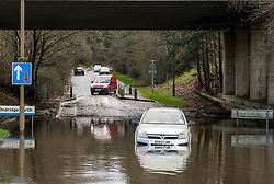 Storm Ciara, 9 February 2020<br /> <br /> Pictured: A car is abandoned after becoming stuck in flood waters in Livingston, West Lothian<br /> <br /> Alex Todd | Edinburgh Elite media