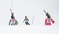 Caleb Seymour and Freddie Sheehan hike up the slalom course as their teammate Jules Townsend skis down during Saturday's High School race at Blackwater Ski Area/Proctor Academy.  (Karen Bobotas/for the Concord Monitor)