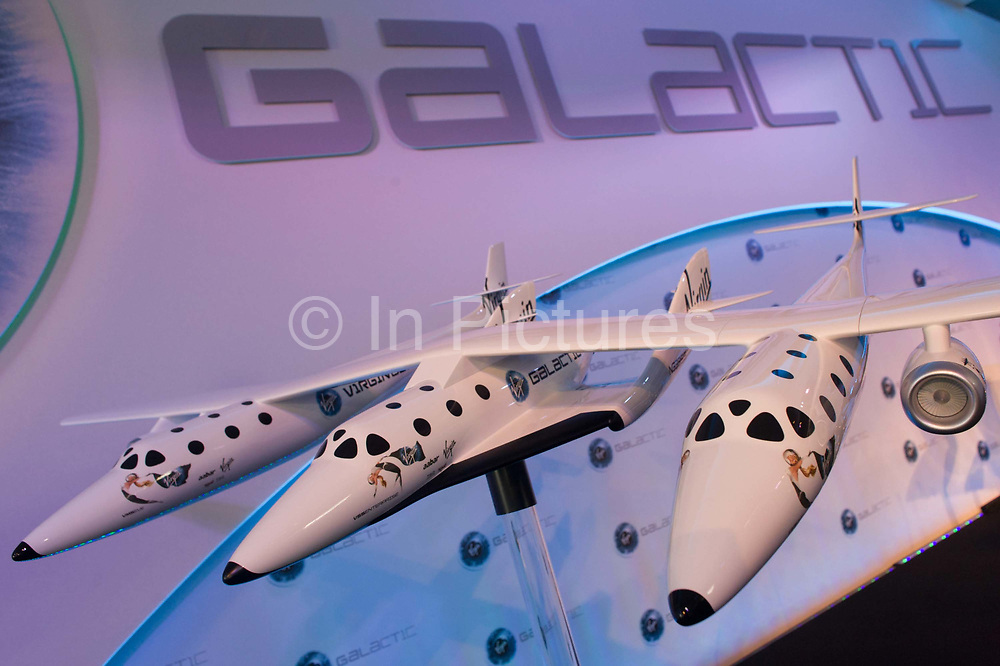 Scale model of Virgin Galactic's WhiteKnightTwo space vehicle with SpaceShipTwo in the middle at air show PR event. Designed by Robert Morgan & James Tighe, the Scaled Composites Model 348 White Knight Two (WK2) is a jet-powered cargo aircraft which will be used to launch the SpaceShipTwo spacecraft. It is being developed by Scaled Composites as the first stage of Tier 1b, a two-stage to suborbital-space manned launch system. WK2 is based on the successful mothership to SpaceShipOne, White Knight, which itself is based on Proteus.